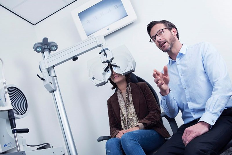 Woman getting having  an eye test by a male Hoya Vision optician