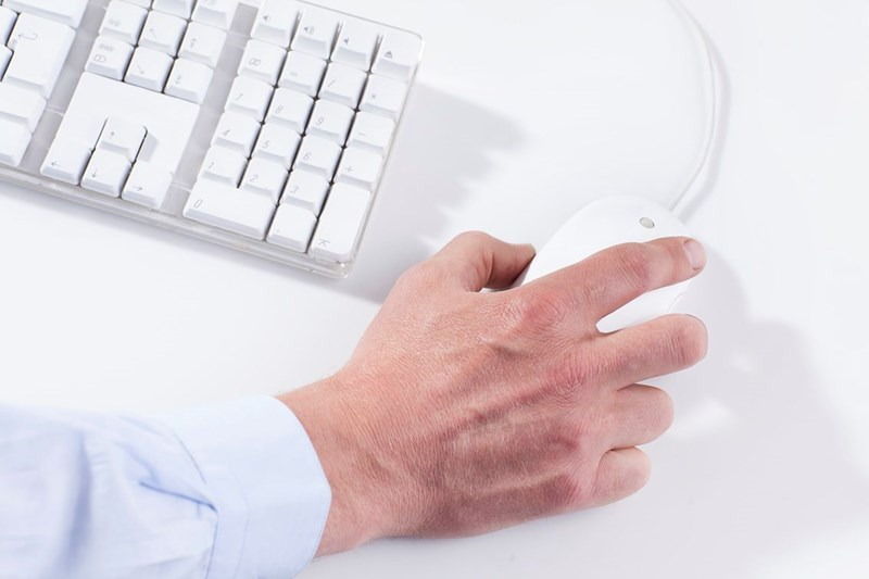Male right hand using a computer mouse