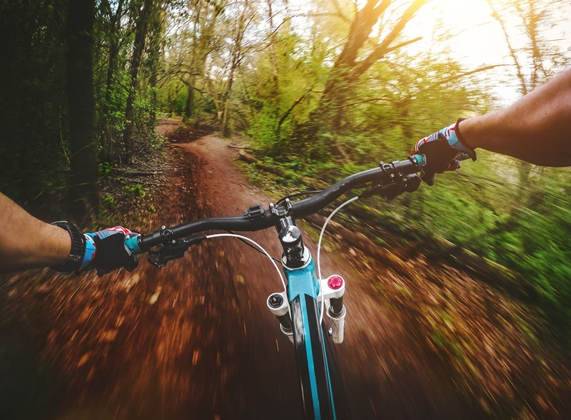 Male mountainbiking at speed in forest