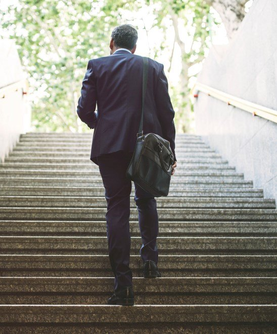 Businessman walking up a flight of stairs