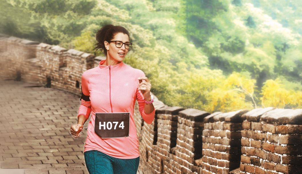 Female runner in pink top outside wearing eyeglass frames