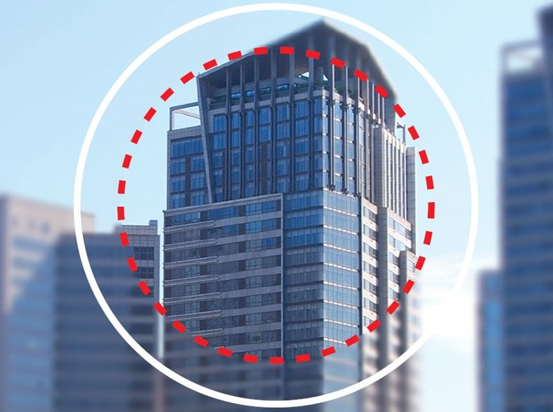 Image of skyscraper blurred through eyeglass lens with red circle round the centre