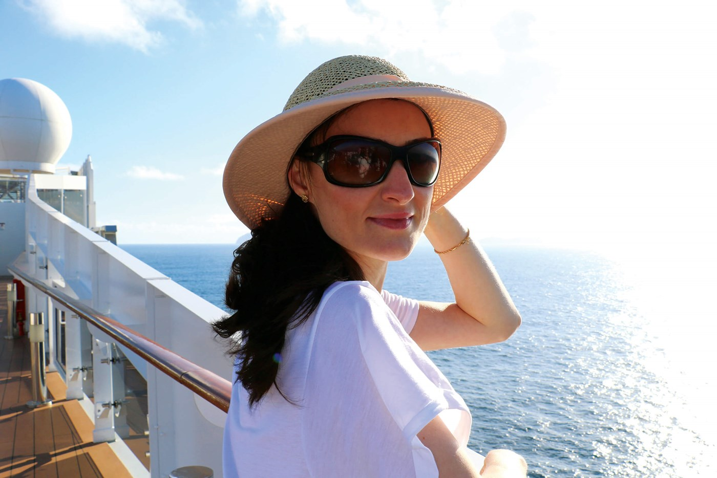 Female wearing tinted eyeglasses and sun hat in sun