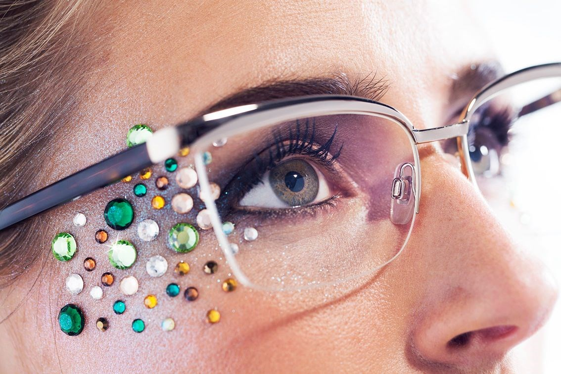 Woman wearing eyeglasses with jewels on her face