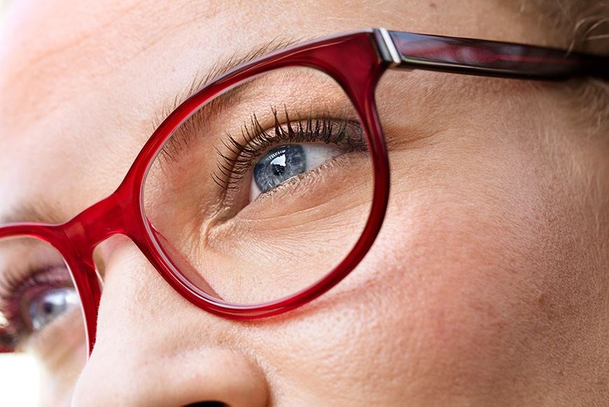 Close shot of woman wearing red frames
