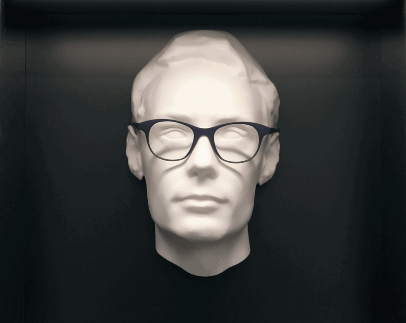 Fake head model with a pair of dark glasses frames on